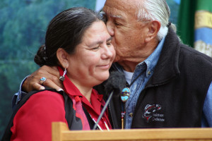 Billy Frank, Jr. (1931-2014), former chariman of Northwest Indian Fisheries Commission and posthumous recipient of the Presidential Medal of Freedom embraces Elwha Chairwoman, Frances Charles at the Elwha dam removal celebration in 2011. The Elwha River Restoration in the Olympic Peninsula was the largest dam removal project in U.S. and potentially world history. Photo: Richard Walker, Indian Country Today Media Network